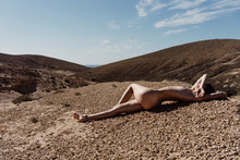 Young Naked Woman On Rock Land...