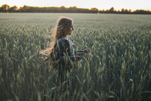 Long Haired Girl Running Through The Field