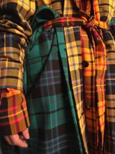 Woman In Bright Trendy Checker...