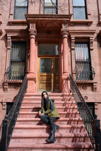 Man Sitting On Stoop Of Browns...