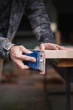 Carpenter Sanding Plank