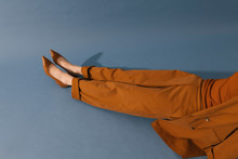 Model With Brown Outfit On Blu...