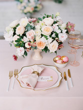 Elegant Table Setting With Flo...