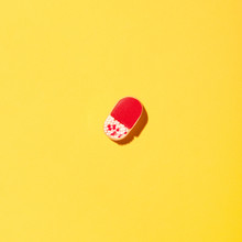 Pills On Yellow Background.