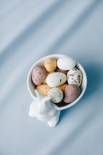 Easter Eggs In A Bowl On A Blue Background