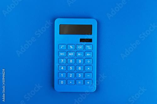 Fotografía Blue bright calculator on a blue background