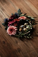 Easter Quail Eggs In Nest Of Flowers And Wild Leaves