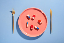Pills On Plate With Fork. Pill...