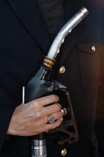 Closeup Hand Holding Fuel Nozz...