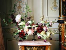 Flower Composition On Nightstand In Classic Interior