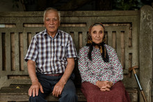 Elderly Man And Woman On Bench