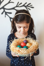 Young Girl Holding A Basket Of...
