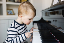 Toddler Playing A Piano