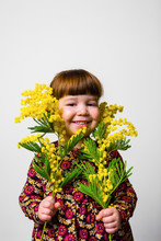 Toddler Girl Studio Portrait With Mimosa Flowers