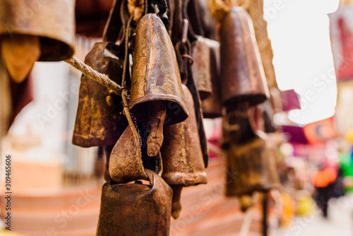 Antique metal cowbells hanging. Canvas Print