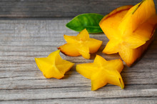 Starfruit Or Averrhoa Carambola On Old Wooden Table.Exotic Tropical Fruit Background.Healthy Food,vegetarian Or Diet Concept.