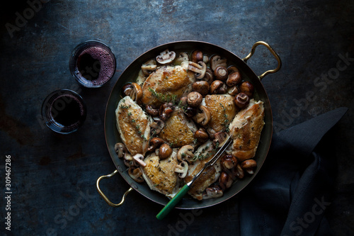 Roasted chicken with mushrooms and herb garnish - 309467286