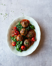 Meatballs With Roasted Tomatoes And Spinach