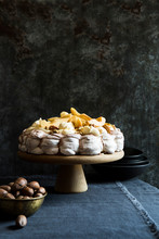 Chocolate Swirl Pavlova With Caramelized Pear And Crushed Pecan