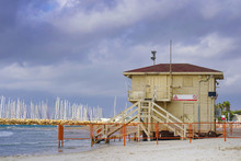 Lifeguard Station On The Beach In Tel Aviv Against A Cloudy, Stormy Sky. Israel.
