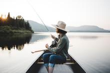 Woman Fly Fishing In A Canoe O...