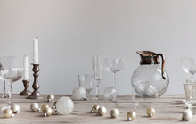 Cocktail And Drinks Glasses With Scattered Christmas Decorations On Wooden Table