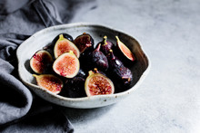 Halved Figs In A Bowl On A Whi...