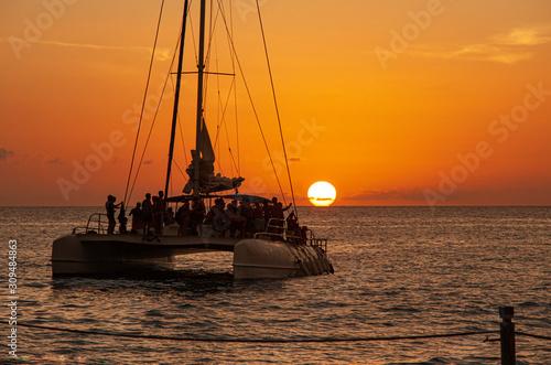 Fotografia Catamaran sails at sunset