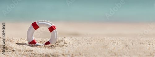 Fotografia Lifebuoy On Sand At Beach