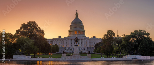 Photo Panoramic image of the Capitol of the United States with the capitol reflecting pool in morning light