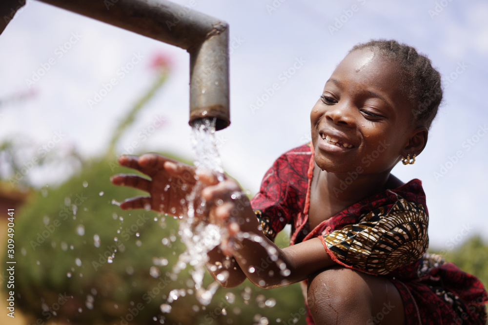 Fototapeta Water is Life for African Children, Little Gorgeous Black Girl Drinking from Tap