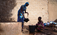 African Schoolgirls Collecting Water From Malian Well