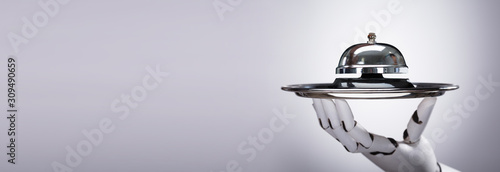 Fotografía Robot Holding Service Bell In Plate