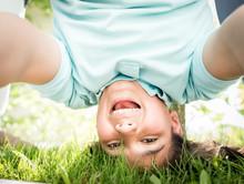 Happy Upside Down Boy In Grass