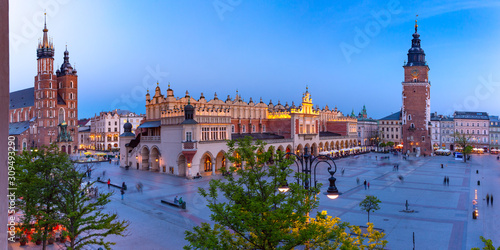 Fototapeta Aerial panorama of Medieval Main market square with Basilica of Saint Mary, Cloth Hall and Town Hall Tower in Old Town of Krakow at night, Poland obraz