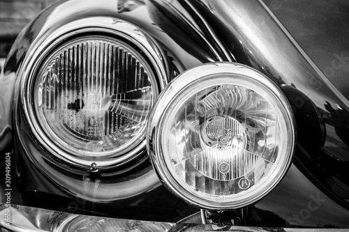 Fototapeta STUTTGART, GERMANY - MARCH 04, 2017: Headlamp of a compact car Volkswagen Beetle Cabrio, 1976