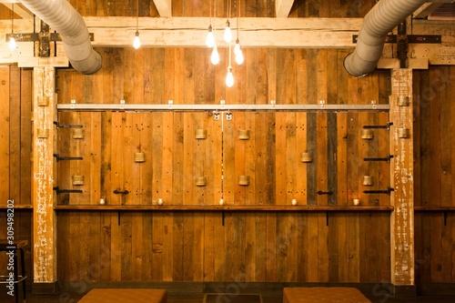 Wooden wall of a cellar with hanging light bulbs Tapéta, Fotótapéta