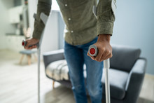 Man With Broken Leg Walking On Carpet