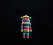 A Soft Striped Plush Toy Monkey.