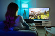 Leinwanddruck Bild - Woman Watching TV While Relaxing On Sofa