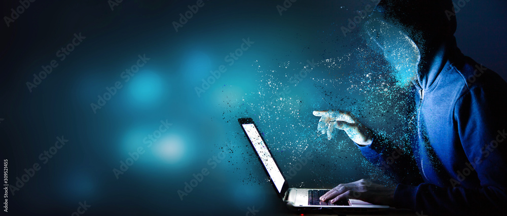 Fototapeta Hacker with laptop. Computer crime.