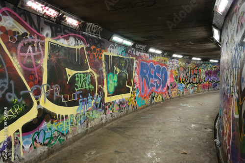Graffiti covered walls of an underground pedestrian walkway in Belfast, Northern Ireland. - 309526856