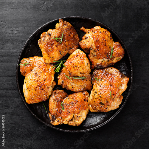 Obraz Grilled chicken thighs with spices and lemon. Top view - fototapety do salonu