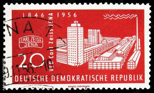Fotografie, Tablou  Postage stamp printed in Germany shows Zeiss-Werke, Jena, Carl Zeiss Company ser
