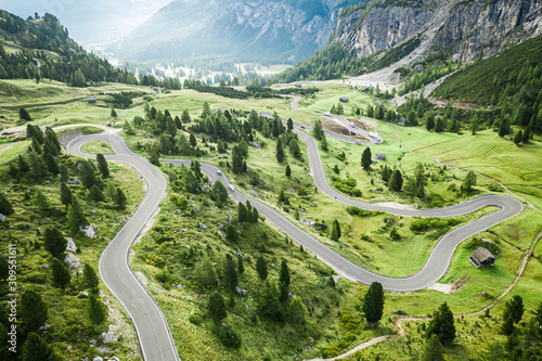 Obraz Winding road and green hills, Passo Gardena, Dolomites, aerial view - fototapety do salonu