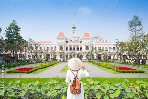 "Tourist woman is sightseeing at famous landmark of Hochiminh City ""People's of Committee of Hochiminh City"" in Vietnam."