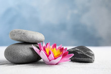 Zen Garden. Beautiful Lotus Flower And Stones On White Sand, Space For Text