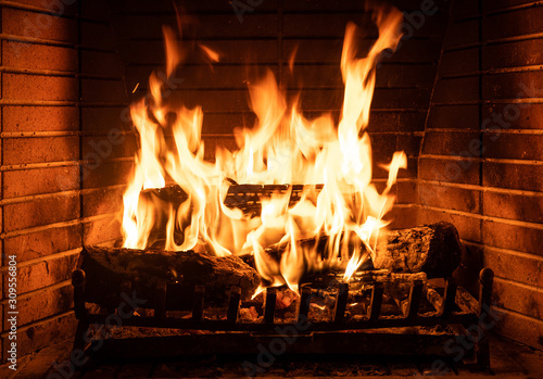 Burning fireplace, real wood logs, cozy warm home at xmas time