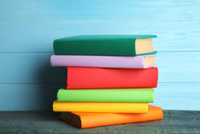 Stack Of Colorful Books On Lig...