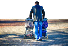 Father On A Walk With Two Baby...